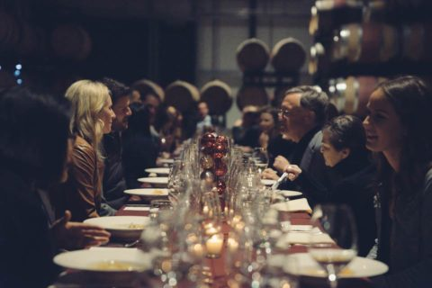 Guests at dinner table in barrel room